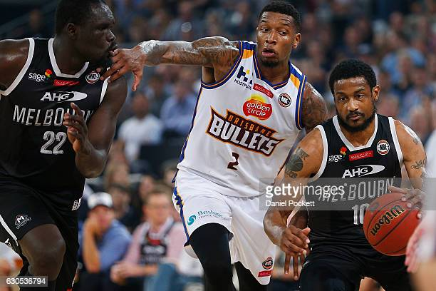 Ramone Moore of Melbourne United dribbles past Torrey Craig of the Brisbane Bullets during the round 12 NBL match between Melbourne and Brisbane at...