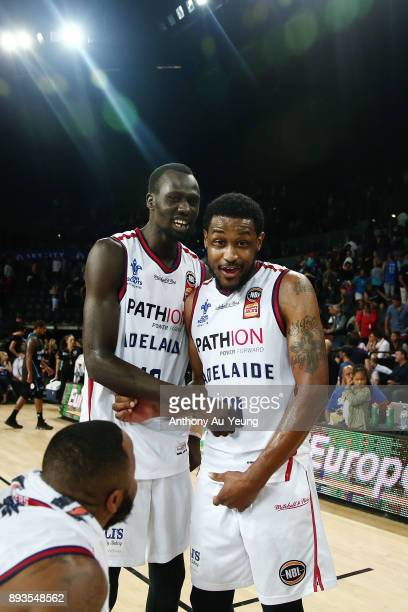 Ramone Moore of the 36ers celebrates with teammate Majok Deng after winning the round 10 NBL match between the New Zealand Breakers and the Adelaide...