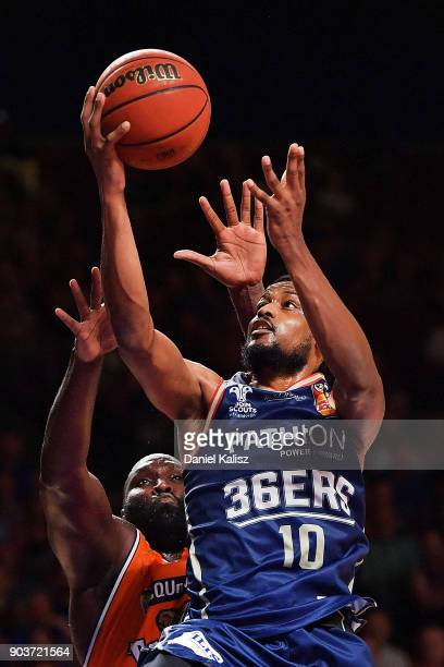 Ramone Moore of the Adelaide 36ers drives to the basket over Nathan Jawai of the Taipans during the round 14 NBL match between the Adelaide 36ers and...