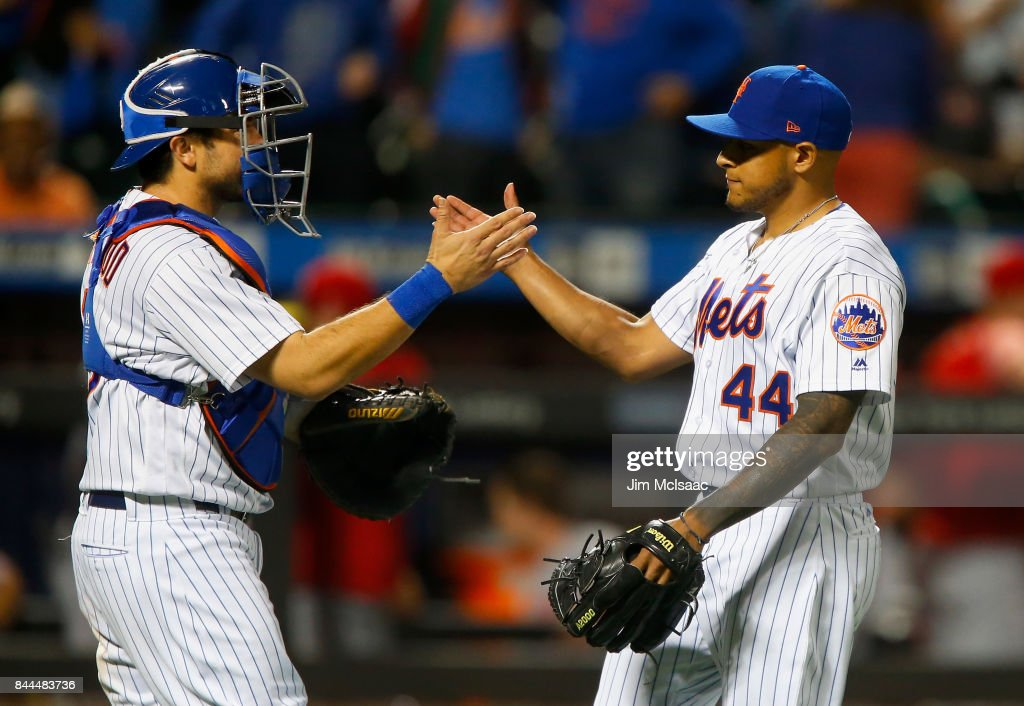 AJ Ramos #44 and Travis d'Arnaud #18 of the New York Mets celebrate after defeating the Cincinnati Reds at Citi Field on September 8, 2017 in the Flushing neighborhood of the Queens borough of New York City.
