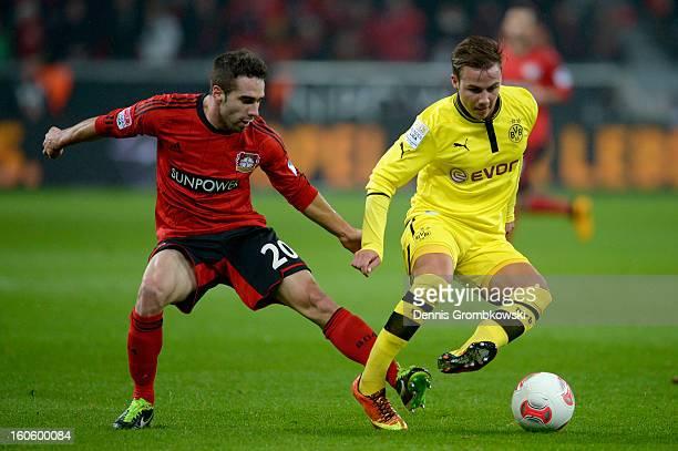 Ramos Carvajal of Leverkusen challenges Mario Goetze of Dortmund during the Bundesliga match between Bayer 04 Leverkusen and Borussia Dortmund at...