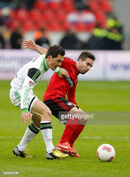 Ramos Carvajal of Leverkusen tries to reach the ball before Marcel Schaefer of Wolfsburg during the German first division Bundesliga football match...