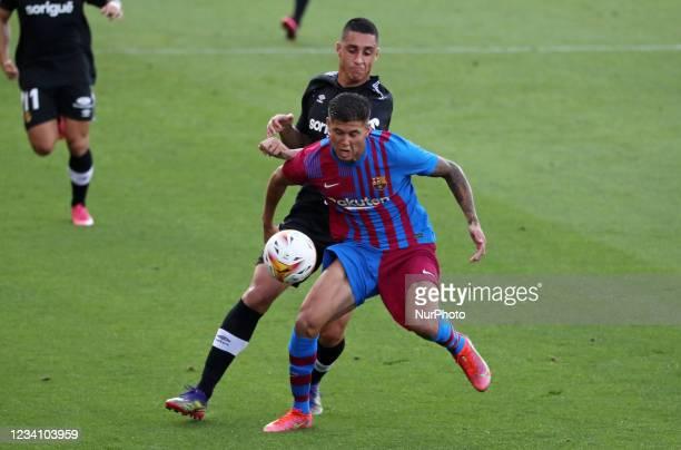 Ramos Mingo and Pablo Fernandez during the friendly match between FC Barcelona and Club Gimnastic de Tarragona, played at the Johan Cruyff Stadium on...
