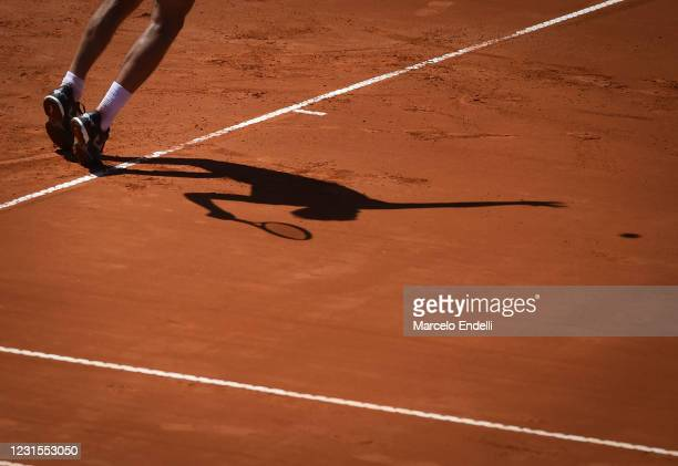 Ramos-Viñolas of Spain silhouette as he serves during a match against Francisco Cerundolo of Argentina with a part of first semifinal during day 6 of...