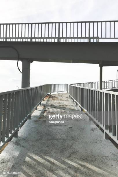 ramp on a metallic walkway - elevated walkway stock pictures, royalty-free photos & images