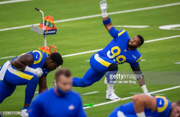 Rams Aaron Donald No. 99, stretches during scrimmage at SoFi Stadium Saturday, Aug. 22, 2020 in Inglewood, CA. Brian van der Brug / Los Angeles Times...