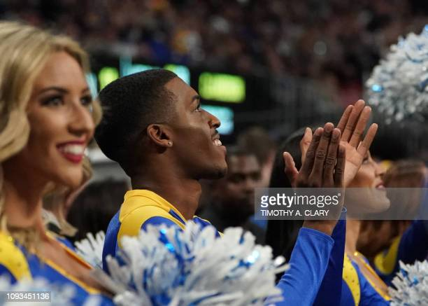 Rams cheerleader Quinton Peron claps during Super Bowl LIII between the New England Patriots and the Los Angeles Rams at MercedesBenz Stadium in...