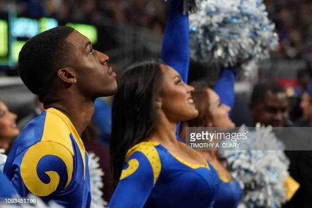 Rams cheerleader Quinton Peron looks on during Super Bowl LIII between the New England Patriots and the Los Angeles Rams at MercedesBenz Stadium in...