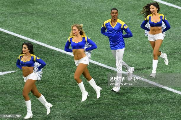 TOPSHOT Rams cheerleader Quinton Peron performs with other cheerleaders during Super Bowl LIII between the New England Patriots and the Los Angeles...