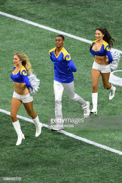 Rams cheerleader Quinton Peron performs with other cheerleaders during Super Bowl LIII between the New England Patriots and the Los Angeles Rams at...