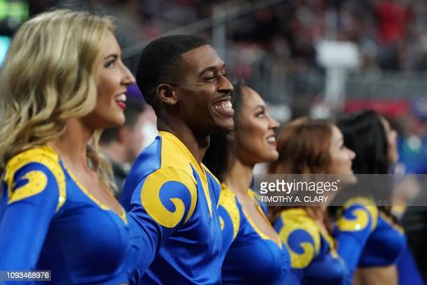 Rams cheerleader Quinton Peron smiles during Super Bowl LIII between the New England Patriots and the Los Angeles Rams at MercedesBenz Stadium in...