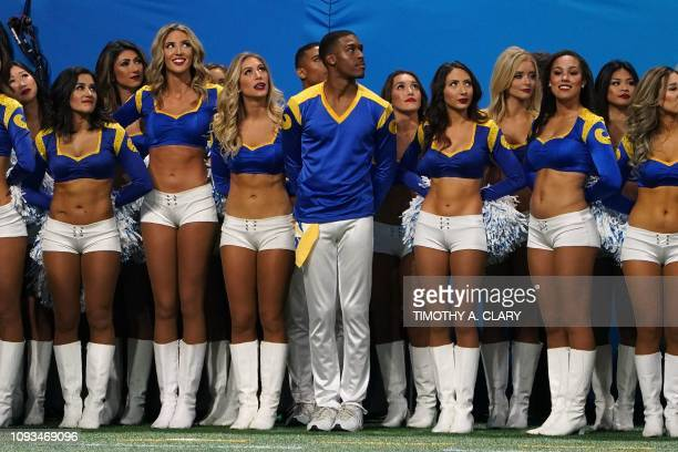 Rams cheerleader Quinton Peron stands with other cheerleader during Super Bowl LIII between the New England Patriots and the Los Angeles Rams at...