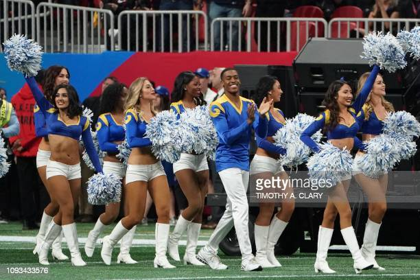 TOPSHOT Rams cheerleader Quinton Peron walks onto the pitch with other cheerleaders during Super Bowl LIII between the New England Patriots and the...