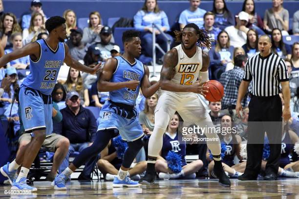 Rams forward Mo AlieCox defended by Rhode Island Rams forward Kuran Iverson and Rhode Island Rams forward Cyril Langevine during the first half of a...