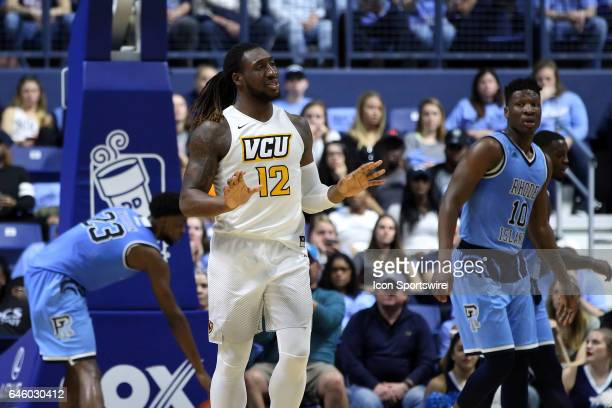 Rams forward Mo AlieCox gestures to teammates to calm down during the first half of a college basketball game between VCU Rams and Rhode Island Rams...