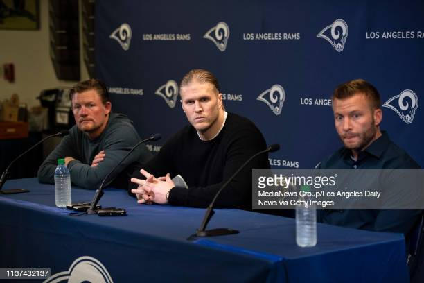Rams General Manager Les Snead linebacker Clay Matthews and head coach Sean McVay during a press conference at the Rams practice facility in Thousand...