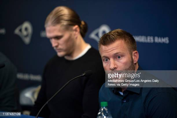 Rams head coach Sean McVay speaks with linebacker Clay Matthews in the background during a press conference at the Rams practice facility in Thousand...