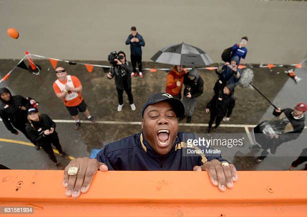 Rams Super Bowl XXXIV Champion Roland Williams lifts himself up the 'Reach Around' Obstacle during the Tough Mudder's 'Mudder Beach' Event which...