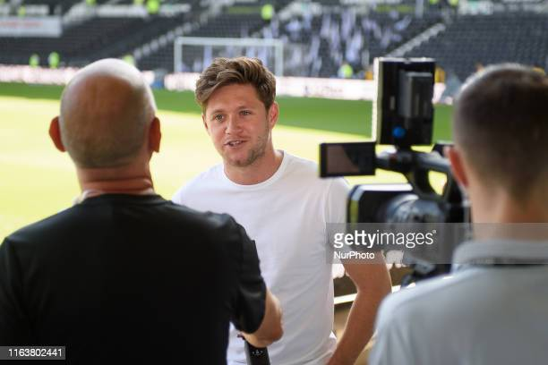 Rams supporter and One Direction singer Niall Horan being interviewed ahed of the Sky Bet Championship match between Derby County and West Bromwich...