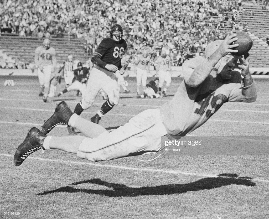 Jim Benton Leaping for Football : News Photo