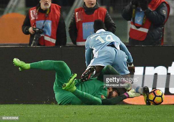 Ramses Becker Alisson of AS Roma and Diao Keita Balde of SS Lazio in action during the TIM Cup match between SS Lazio and AS Roma at Olimpico Stadium...