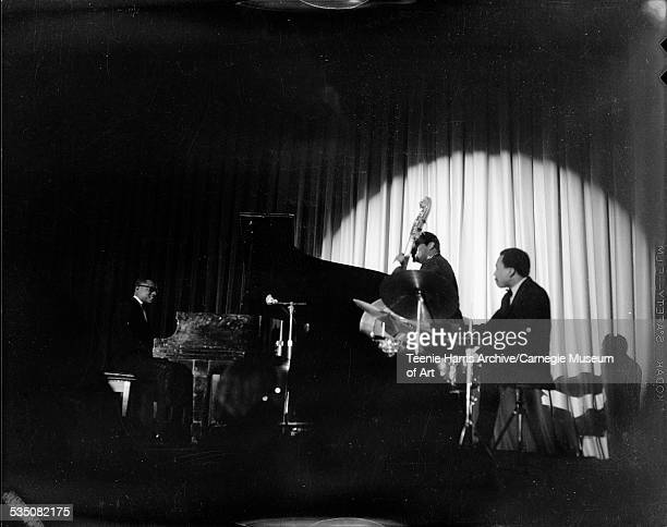 Ramsey Lewis band with Ramsey Lewis on piano Cleveland Eaton on bass and Maurice White on drums performing in Hilton Hotel for Walt Harper Jazz...