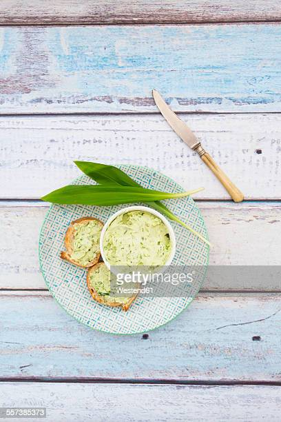 Ramson butter, ramson, and slices of baguette