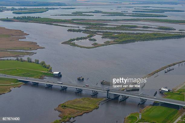 "ramspolbridge and storm barrier with ijssel delta in the background - ""sjoerd van der wal"" imagens e fotografias de stock"