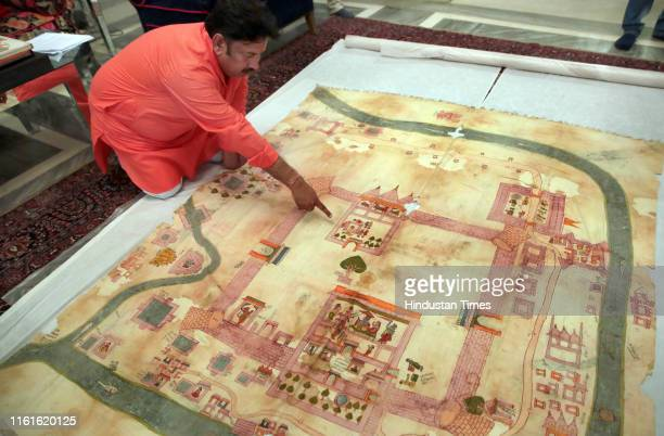 Ramu Ramdev OSD at the City Palace points out Lord Ramas birth place in an old dilapidated map of Ayodhya depicting the birthplace of Lord Rama being...