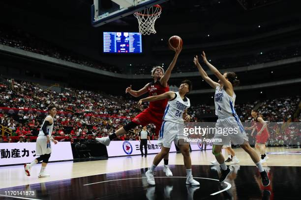 Ramu Tokashiki of Japan contest a rebound against Hsiang Ting Huang of Chinese Taipei during the game two of the women's basketball international...