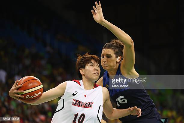 Ramu Tokashiki of Japan drives past Helena Ciak of France during the Women's preliminary round group A basketball match between Japan and France on...