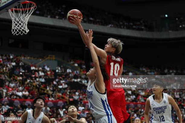 Ramu Tokashiki of Japan drives to the basket against Pei Chen Tsai of Chinese Taipei during the Game One of the women's basketball international game...