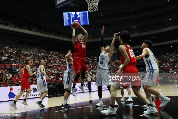 Ramu Tokashiki of Japan drives to the basket against Pei Chen Tsai of Chinese Taipei during the game two of the women's basketball international game...