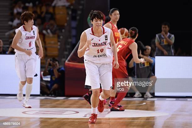 Ramu Tokashiki of Japan runs in finals match between Japan and China during the 2015 FIBA Asia Championship for Women at Wuhan Sports Center...