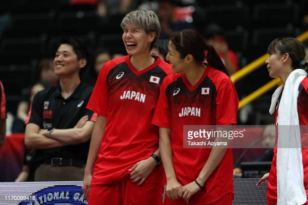 Ramu Tokashiki of Japan smiles with Yuki Miyazawa after defeating Chinese Taipei in the game two of the women's basketball international game between...