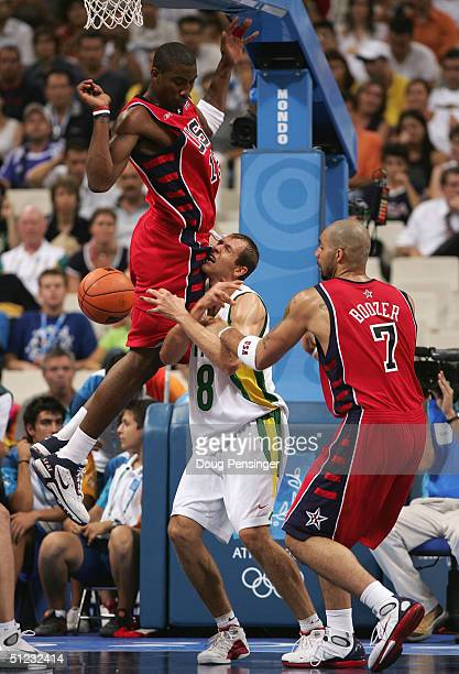 Ramunas Siskauskas of Lithuania and Amare Stoudemire of the United States clash during the men's basketball bronze medal contest game on August 28...