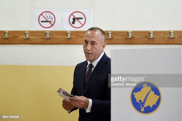 Ramush Haradinaj prime minister candidate and leader of the Alliance for Future of Kosovo prepares to cast his ballot in Pristina during early...