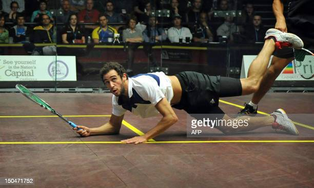 Ramy Ashour of Egypt falls down on the court while playing against Omar Mosaad of Egypt in the men's final at the Australian Open squash tournament...