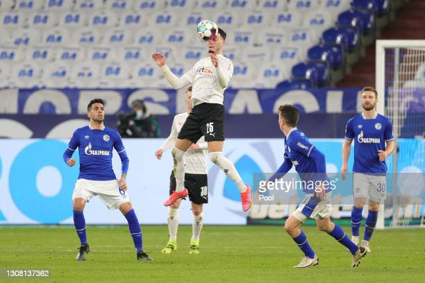 Ramy Bensebaihni of Borussia Moenchengladbach heads the ball during the Bundesliga match between FC Schalke 04 and Borussia Moenchengladbach at...