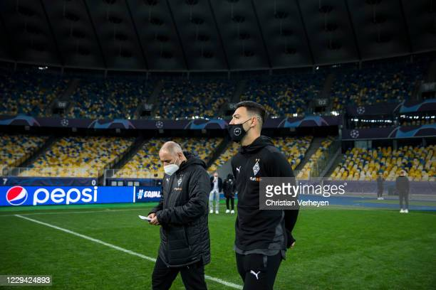 Ramy Bensebaini and Assistant Coach Oliver Neuville of Borussia Moenchengladbach are seen during a site visit of Borussia Moenchengladbach ahead the...