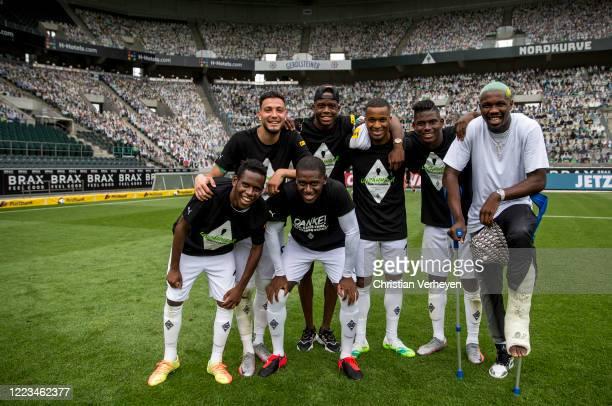 Ramy Bensebaini Denis Zakaria Alassane Plea Breel Embolo Marcus Thuram Ibrahima Traore and Mamadou Doucoure of Borussia Moenchengladbach pose for a...