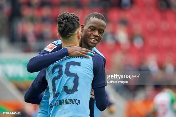Ramy Bensebaini of Borussia Moenchengladbach and Denis Zakaria of Borussia Moenchengladbach celebrates after scoring his team`s 01 during the...