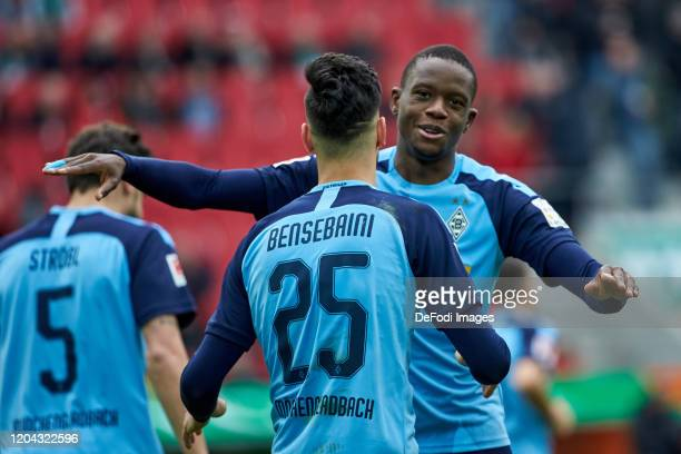 Ramy Bensebaini of Borussia Moenchengladbach and Denis Zakaria of Borussia Moenchengladbach celebrates after scoring his team`s first goal during the...