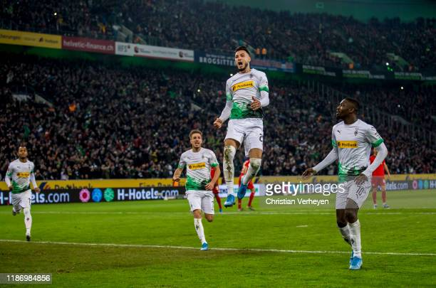 Ramy Bensebaini of Borussia Moenchengladbach celebrate after he score his teams second goal by penalty during the Bundesliga match between Borussia...