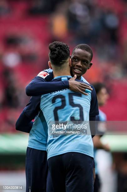 Ramy Bensebaini of Borussia Moenchengladbach celebrate with Denis Zakaria after he score his teams first goal during the Bundesliga match between FC...