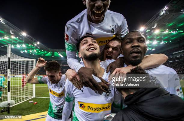 Ramy Bensebaini of Borussia Moenchengladbach celebrate with his team mates after he score his teams second goal by penalty during the Bundesliga...