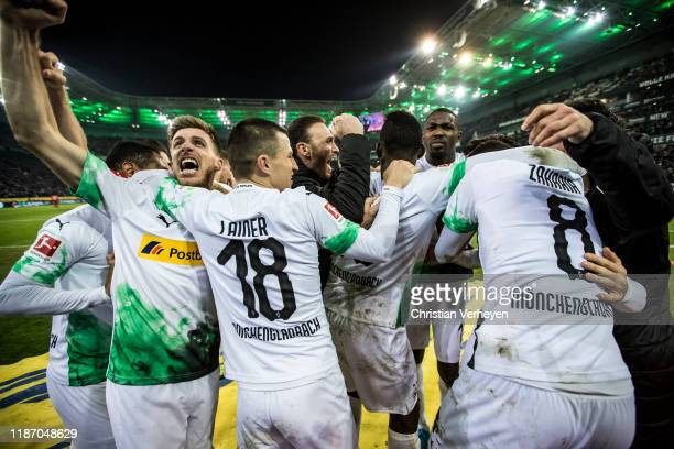 Ramy Bensebaini of Borussia Moenchengladbach celebrate with his team mates after he score his teams second goal during the Bundesliga match between...