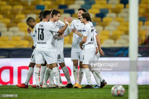 Ramy Bensebaini of Borussia Moenchengladbach celebrate with team mates after he score his teams first fourth during the Group B UEFA Champions League...