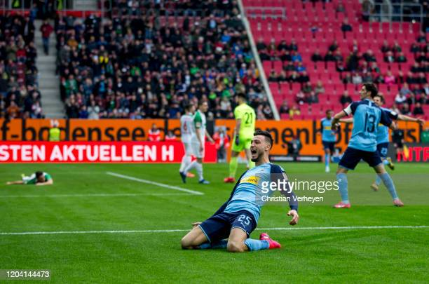 Ramy Bensebaini of Borussia Moenchengladbach celebrates after he scores his team's first goal the Bundesliga match between FC Augsburg and Borussia...