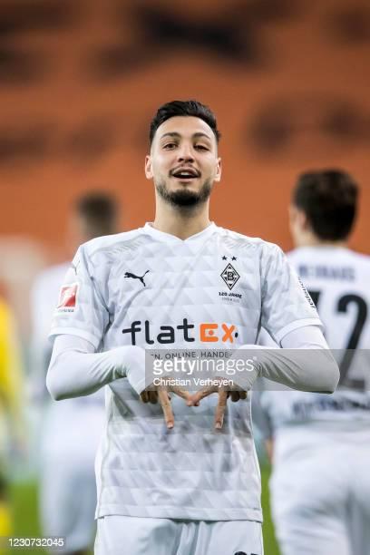 Ramy Bensebaini of Borussia Moenchengladbach celebrates after he scored his teams third goal during the Bundesliga match between Borussia...